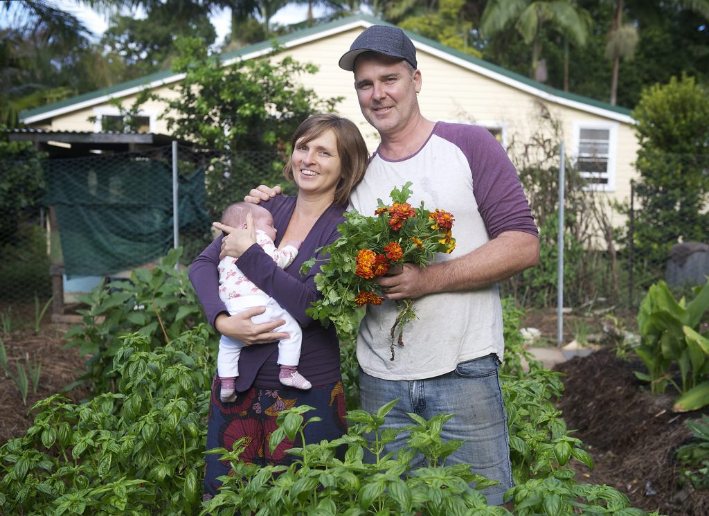 Byron Spice Palace owners Duska Jefed and Rob Cullinan in their garden at The Pocket with new baby daughter, Ginger. Photo: Kate O'Neill